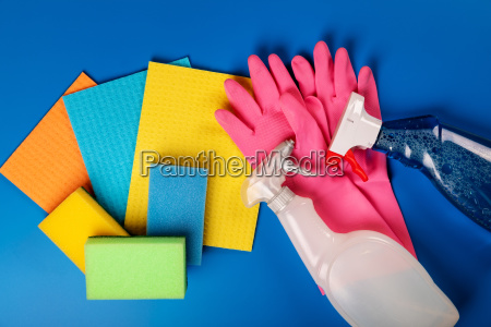 colorful cleaning equipment on blue background
