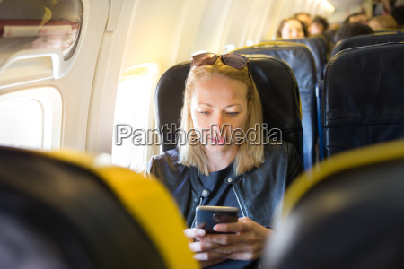 woman using mobile phone as entertainment