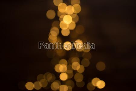 dark background with golden bokeh