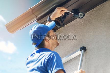 man install outdoor surveillance ip camera
