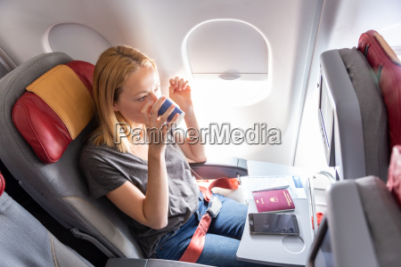 woman drinking coffee on commercial passengers