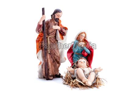 weihnachtskrippe mit heiliger familie isoliert auf