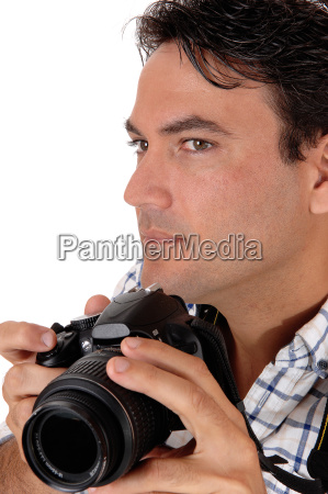 a young man holding his camera