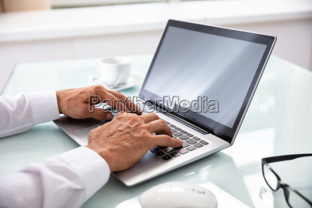 businessmans hand using laptop