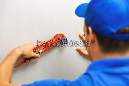 plumber installing water shutoff valve for