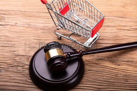 judge gavel and shopping cart on