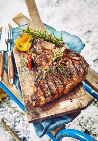 seasoned grilled t bone steak at