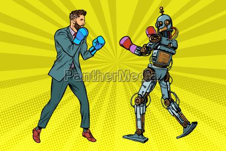 man boxte mit einem roboter