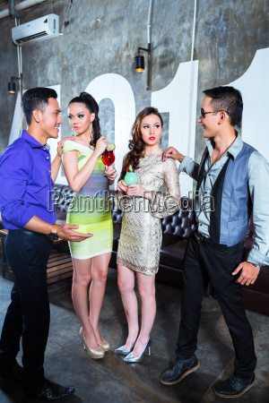 asian young party couples drinking cocktails