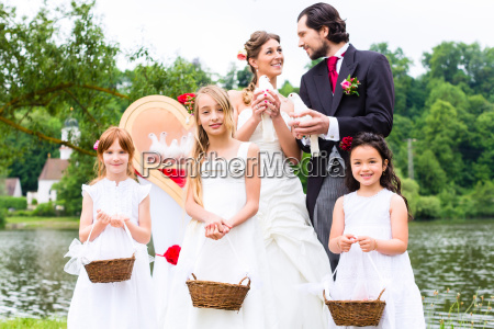 wedding couple and flower children with