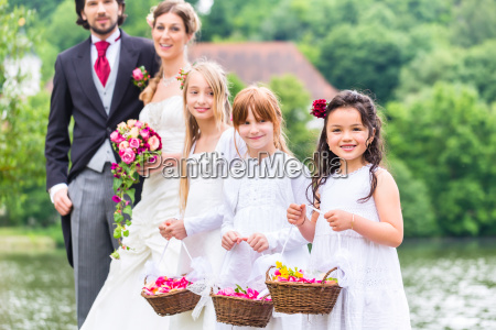 wedding bridesmaids children with flower basket