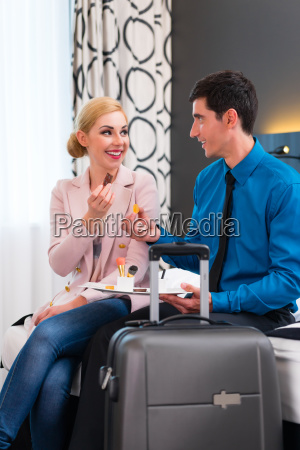 man and woman arriving in hotel