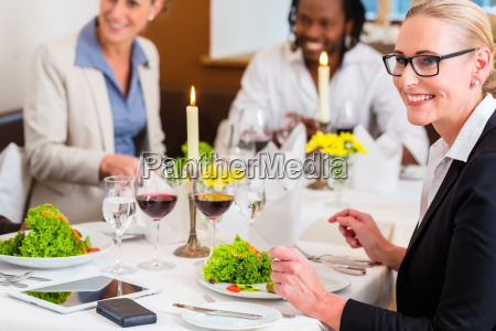 people in restaurant at business lunch