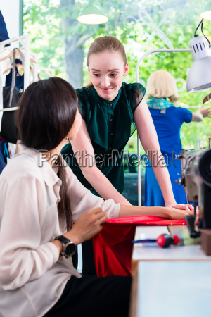 female fashion designers in conversation in