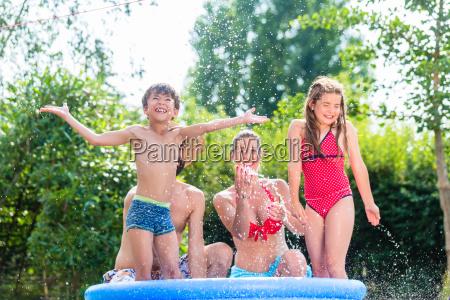 family cooling down splashing water in
