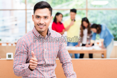 portrait of young confident asian employee