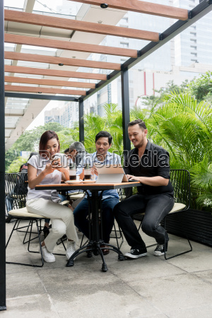 friends using devices connected to the