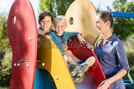 family playing on adventure playground children