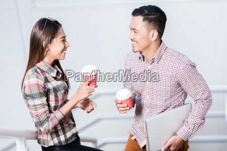 young man and woman talking while