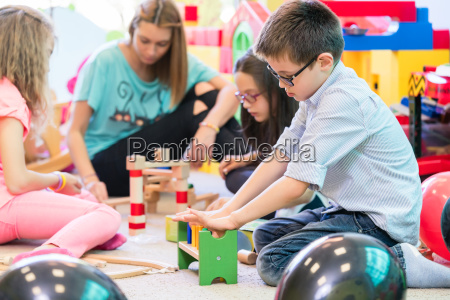 pre school boy cooperating with kids