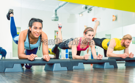 beautiful young woman exercising a plank