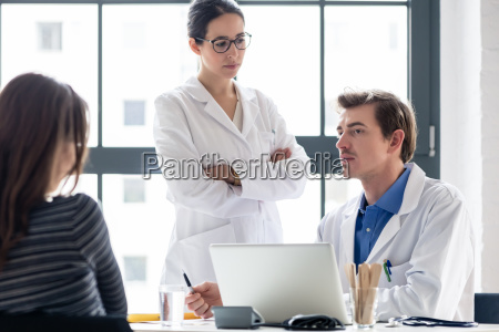 young nurse listening to an experienced
