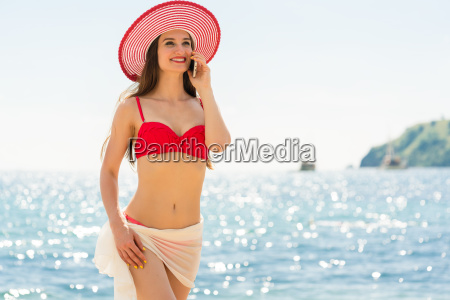 fashionable fit young woman talking on