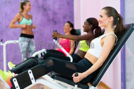 beautiful woman smiling while exercising at