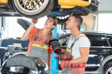 experienced female auto mechanic with her