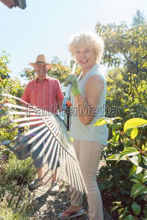 cheerful senior woman holding a leaf