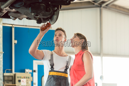 auto mechanic checking the disk brake