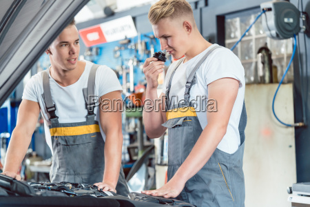 experienced auto mechanic checking the parts