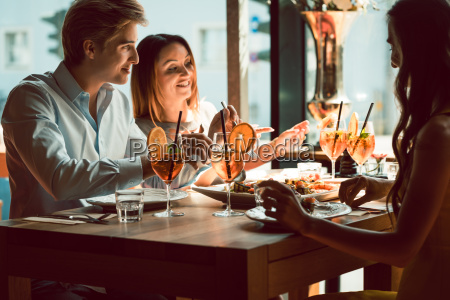 young woman smiling during lunch with