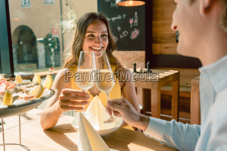 beautiful woman toasting during a romantic