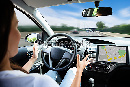 woman traveling by self driving car