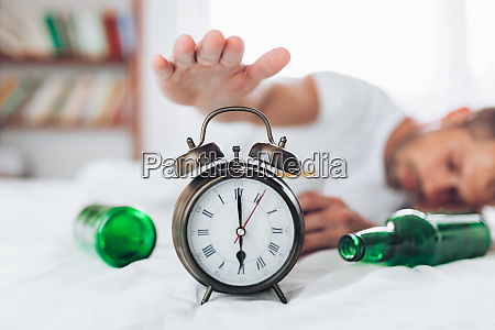 young man in bed the morning