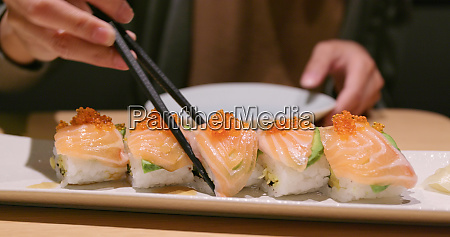 woman enjoy the japanese sushi in