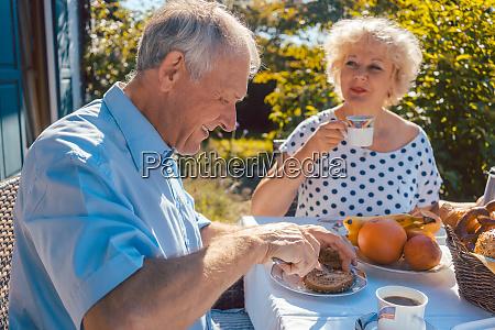 senior woman and man having breakfast