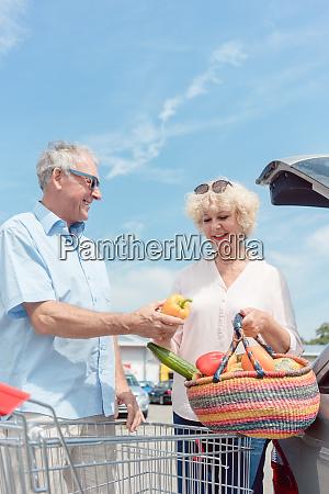 senior man holding a shopping cart