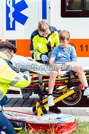 emergency doctors caring for accident victim