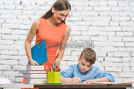 teacher helping student with difficult task