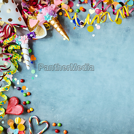 carnival border with hats candy and