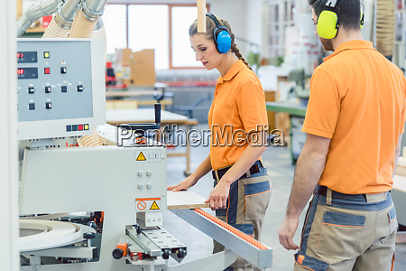 workers in furniture factory in the