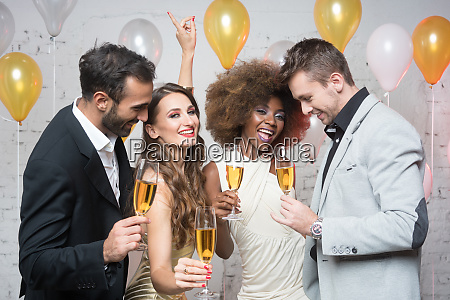 group of party people celebrating with