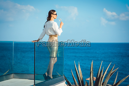woman enjoying glass of champagne at