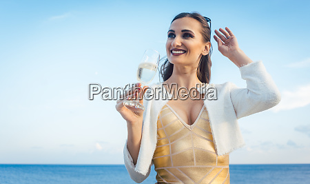 woman sitting by the sea at