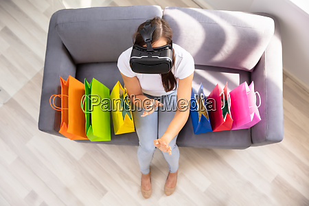 woman doing shopping with virtual reality