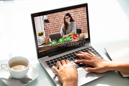 businesswoman video conferencing on laptop