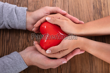 couple holding red heart