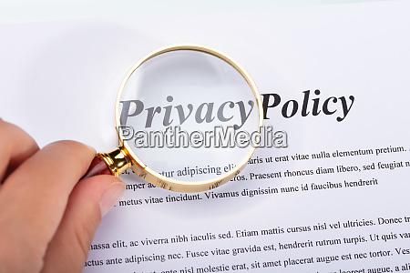 woman holding magnifying glass over privacy